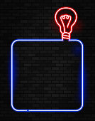 glowing light bulb neon sign board copy space