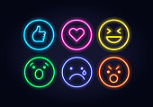 Vector neon icon set for social media. Thumb up, heart and smiles illuminated glowing symbols in circle frame isolated on black. Emoticon element of UI design for web, promotion, advertisement.