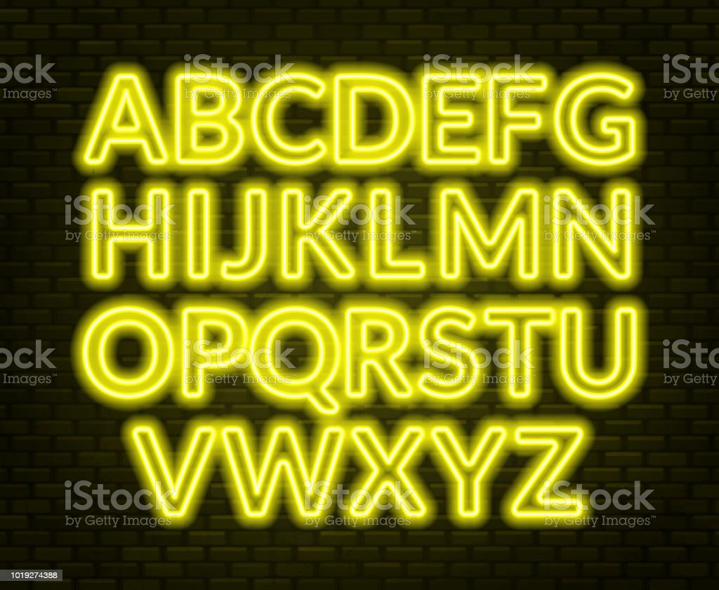 Neon Yellow Alphabet On Brick Wall Background Capital Letter Stock ...