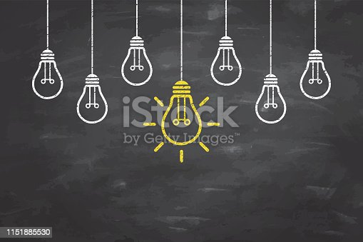 New Idea Concepts with Light Bulb on Blackboard Background