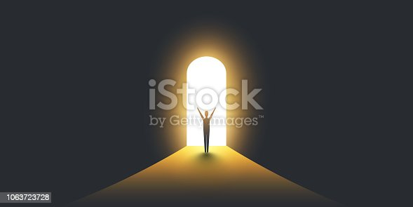 Businessman Standing in Dark, Symbol of Light at the End of the Tunnel