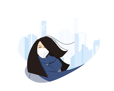 New type coronavirus 2019-nCoV, a Chinese Girl walks down a city street in a respirator mask.