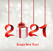2021 New Year background with gift box and red ribbons. Vector.