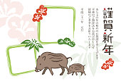 New Year card with wild pigs and photo frames