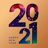 Celebrate New Year 2021 with sparkling lights background cut out the shape of 2021 from the gold colored paper