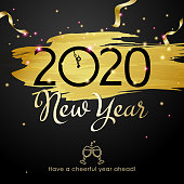 Join the countdown party on the New Year's Eve of 2020 with celebratory toast symbol on the background of gold colored paintbrush, sparkling lights and ribbon