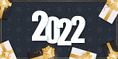 2022 new year dark blue banner. Background with realistic gift boxes, gold ribbons and bow. Vector.