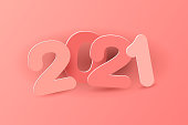 New year 2021 paper cut numbers in delicate pink colors. Multicolor inscription 2021. Vector illustration. Decorative greeting card 2021 new year. Vector illustration