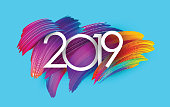 Blue 2019 new year background with spectrum brush strokes. Colorful gradient brush design. Greeting card or poster template. Vector paper illustration.