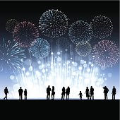 New Year fireworks celebration with silhouetted people in foreground. EPS10 file using transparencies