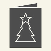 istock New Year postcard solid icon. Greeting card with Christmas tree glyph style pictogram on white background. Winter party invitation letter for mobile concept and web design. Vector graphics. 1220267488