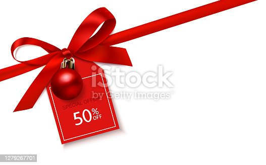 istock New year winter sale design template. Decorative red bow with Christmas ball and price tag on the corner of page. 1279267701