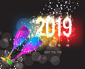 New Years 2019 polygonal colorful triangle glass and fireworks background
