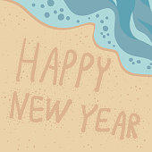 Vector illustration of a sandy beach with azure foamy wave, Happy New Year handwritten on the sand. A design element for vacation. New Years Eve invitation or postcard. Close-up of sand and sea, top view.