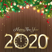 Join the countdown celebrations on the New Year's Eve of 2020 with metallic clock on the  background of decorated pine tree branches and sparkling lights