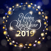 Enjoy the light up party of the New Year 2019 with shiny calligraphy and sparkling lights on the blue background