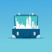 Vector illustration of the New York city skyline in an open travel suitcase