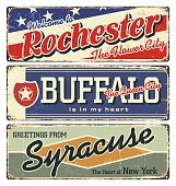 New York tin enamel sign. Vintage city label. Vintage tin sign collection with US cities. Rochester. Buffalo.Syracuse. Retro souvenirs or postcard templates on rust background from New York state.