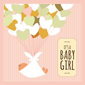 Newborn baby girl card with banner and text.
