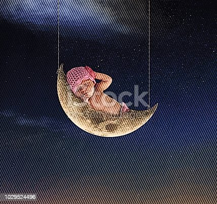 Engraving illustration of a Newborn baby girl sleeping on the moon