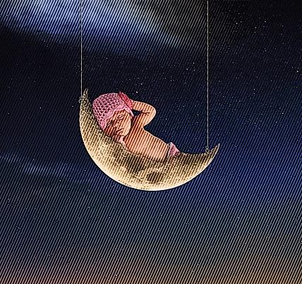 Newborn baby girl sleeping on the moon