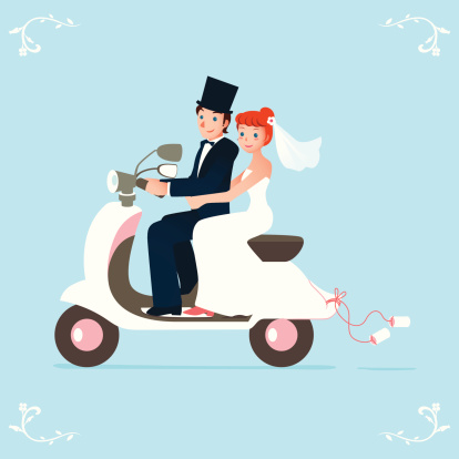 newlywed bride and groom on a scooter
