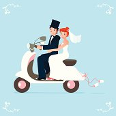 a cute newlywed bride and groom on a scooter!