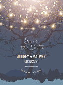 Night Christmas garden full of lights and snow vector design invitation frame. Navy blue and golden wedding card.Party hanging lamp garlands. Gold stars and bokeh glow. Shining shimmer design.