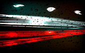 Night city. The trace of light. Raindrops on the glass. Vector.