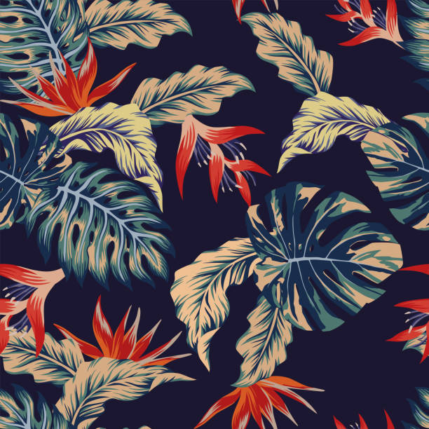 Night jungle seamless pattern Night tropical jungle print seamless pattern leaves and flowers on the dark blue background haiti stock illustrations