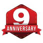 Nine year anniversary badge with red ribbon