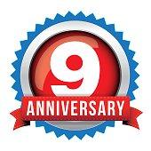 Nine years anniversary badge with red ribbon