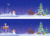 Vector illustration of winter landscapes with a North Pole sign, a reindeer and a Christmas tree, panoramic banners