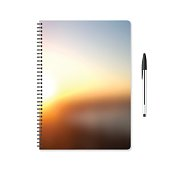 Notepad template with abstract background, blurred sunset and ballpoint pen