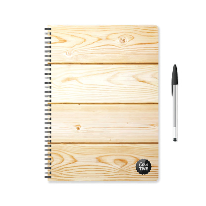 Notepad template with wooden background and ballpoint pen