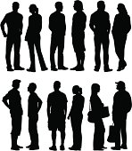 Silhouettes of people standing.