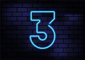 Number 3 Sign Blue Neon Light On Dark Brick Wall. Horizontal composition with copy space.
