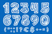 istock Numbers set with extra characters on blueprint paper background. 1300096401