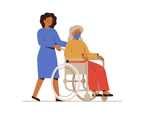 Nurse or social worker helps the elderly disabled patient and drives her in a wheelchair. A young female volunteer is taking care of a senior woman.