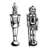Two decorative and festive nutcrackers side by side