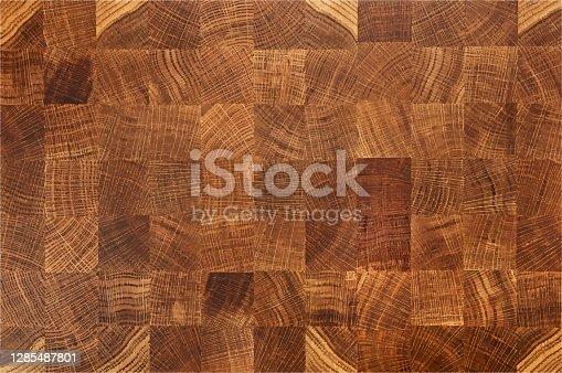 istock Oak wood butcher end grain chopping block board 1285487801