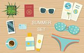 Summer vacation. Objects on wooden background. Top view. Vector flat illustration.