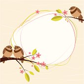 Two birds are on the blooming branch and the third bird is separately. Copy space for the text.