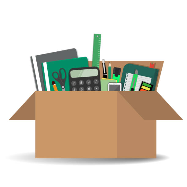 Office accessories in a cardboard box isolated on a white background Office accessories in a cardboard box isolated on a white background. There is a calculator, folders, scissors, a ruler, a pen, a marker and other stationery in the picture. Vector illustration cardboard box stock illustrations