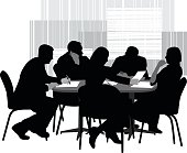 A vector silhouette illustration of business men and woman stitting around a table having a meeting or brainstorming session.  A man writes on  a document while a woman holds a document out looking at it.  Another woman leans back to think and another man talks on a phone.  They are in front of a striped block design pattern.