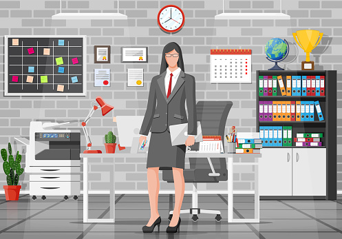 Office building interior with businesswoman