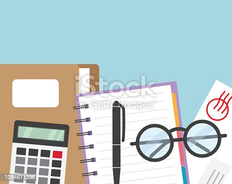 istock office flat lay concept with folder with documents, spiral notebook, letter, eyeglasses and pen calculator 1294611396