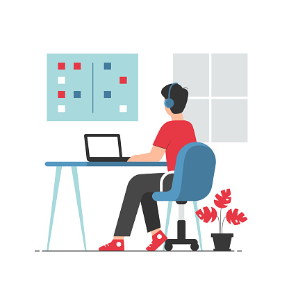 Office worker in casual clothes sitting at desk and working on laptop. Professional office worker at workplace