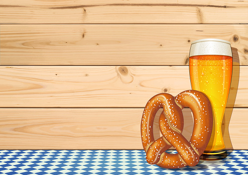 Oktoberfest background [Beer glass and Pretzel on the Wooden boards]