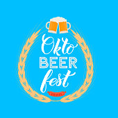 Oktoberfest calligraphy hand lettering on blue background. Traditional Bavarian beer festival. Easy to edit vector template for your  design,  poster, banner, flyer, t-shirt, invitation, etc.